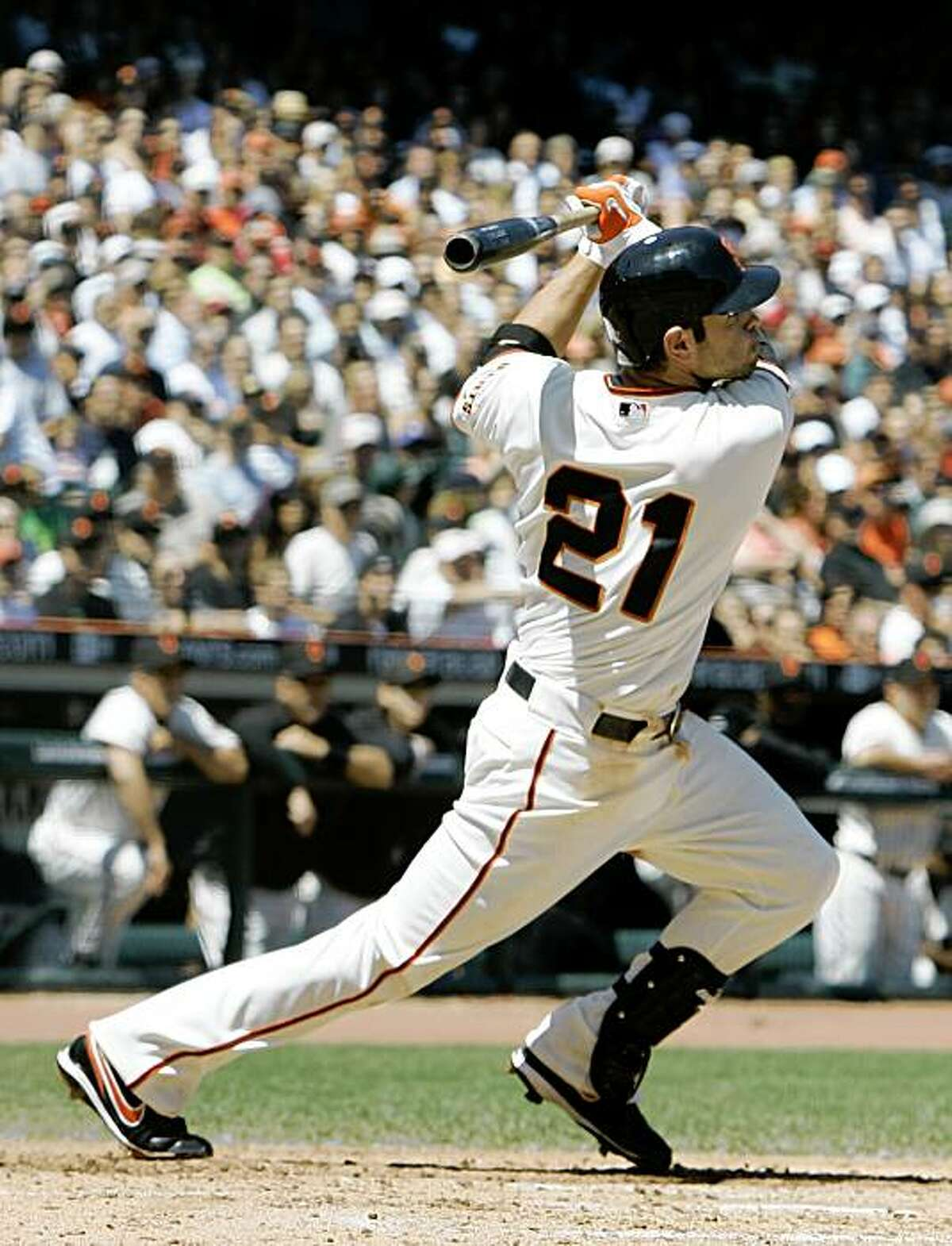 San Francisco Giants' Freddy Sanchez hits a two-RBI double off Philadelphia Phillies starting pitcher Cole Hamels during the fifth inning of a baseball game in San Francisco, Sunday, Aug. 2, 2009. (AP Photo/Eric Risberg)