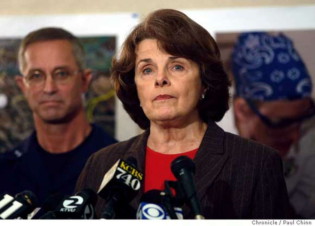 U.S. Senator Dianne Feinstein speaks at a news conference after she was briefed on the progress of the oil spill clean-up efforts by Coast Guard Rear Admiral Craig Bone (left) and other officials at the unified command center on Treasure Island in San Francisco, Calif. on Sunday, Nov. 11, 2007. earlier in the week Feinstein harshly criticized the apparent slow response by the Coast Guard to the accident but she backed off those remarks at a news conference. PAUL CHINN/The Chronicle **Dianne Feinstein, Craig Bone Ran on: 11-19-2007 Sen. Dianne Feinstein has successfully blocked several conservative Bush appointments. Ran on: 12-19-2007 Sen. Dianne Feinstein