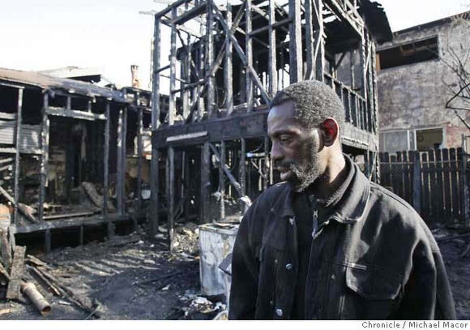 ###Live Caption:Donque Martin, who identified himself as an adopted son of the homeowner, surveys the damage at the rear of the home that was completly destroyed in an earkly morning blaze at 2640 74th st. in Oakland, Calif. that killed two men who were unable to escape, on mar. 18, 2008. Photo by Michael Macor/ San Francisco Chronicle###Caption History:Donque Martin, who identified himself as an adopted son of the homeowner, surveys the damage at the rear of the home that was completly destroyed in an earkly morning blaze at 2640 74th st. in Oakland, Calif. that killed two men who were unable to escape, on mar. 18, 2008. Photo by Michael Macor/ San Francisco Chronicle###Notes:A house fire at 2640 74th St. in East Oakland, claimed the lives of two men who were unable to escape the early morning blaze that completly gutted the single story home.###Special Instructions:Mandatory credit for Photographer and San Francisco Chronicle No sales/ Magazines Out Photo: Michael Macor