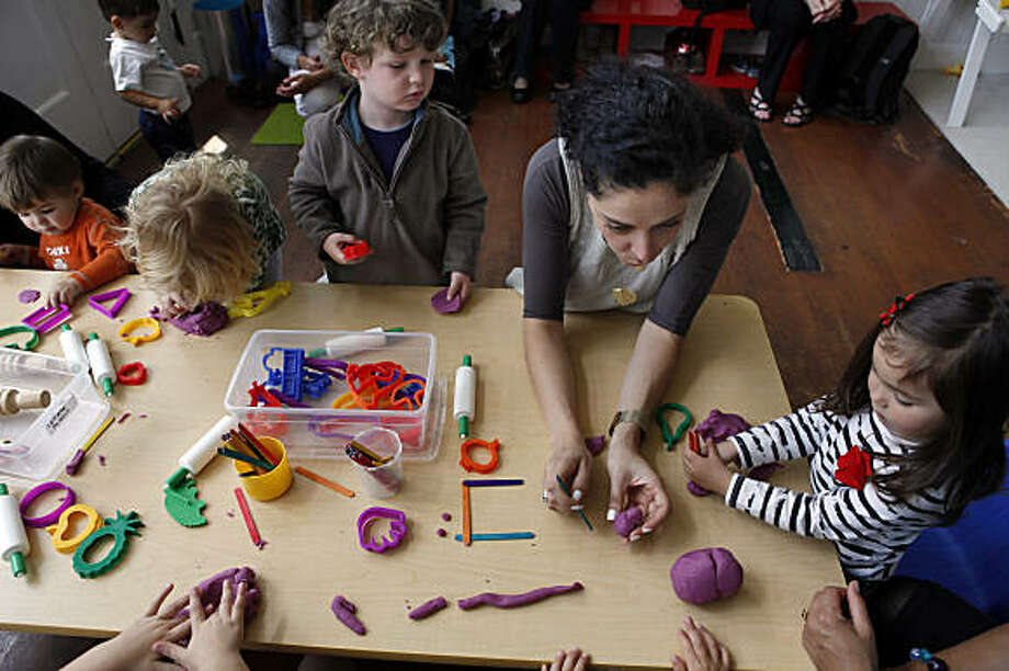 "Teacher, Iliara Giannini works with students completely in spoken italian at Spazio Italiano in San Francisco, Calif., on Wednesday, June 3, 2009. Interest in italian preschools & italian education is exploding in the bay area, more so than anywhere else in the country. the 2 biggest preschools started 5 yrs ago. One of these schools is ""spazio italiano,"" in North Beach, in San Francisco Photo: Carlos Avila Gonzalez, The Chronicle"