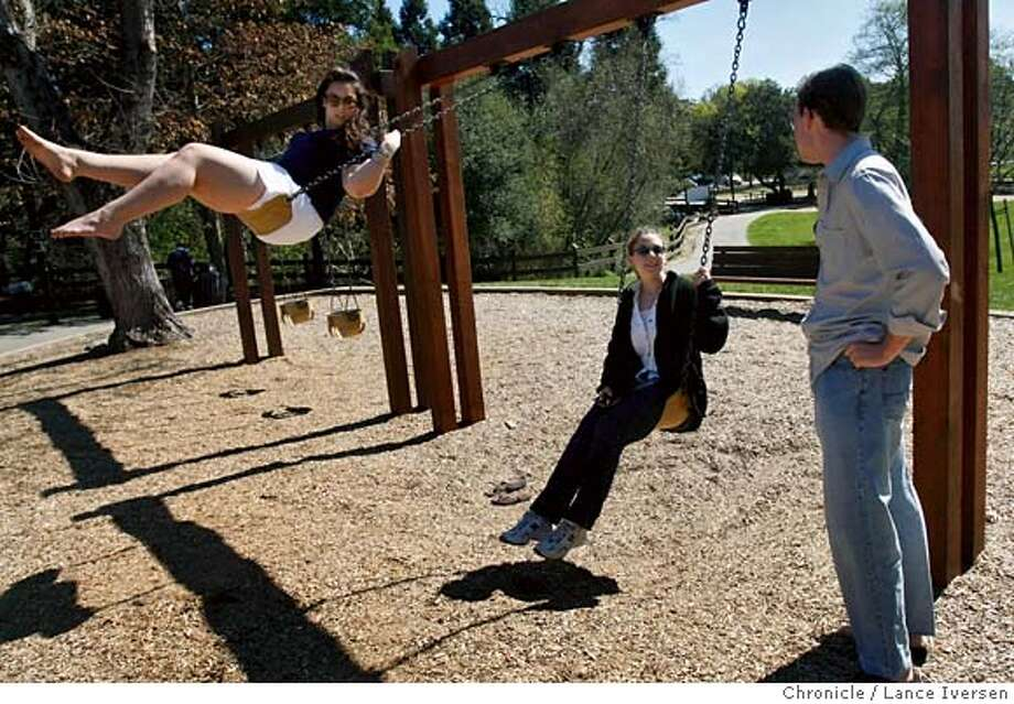 ###Live Caption:Taline Kuyumjiam, Laura Gibble, President of St Mary's College Republicans and Scott Cullinane, All from St Mary's discuss politics while on the swings at Moraga Commons Park in Moraga Saturday, March 8, 2008. Bay Area College Republicans gathered for a low key BBQ hosted by The Bay Area College Republicans, which will include students from the Bay Area as well as across the state. Not only did they play a tag game of football but most of the discussions centered on the November general election. Some say they will toe the party line and support John McCain. However, others are not so sure and continue to support Ron Paul and Mike Huckabee Photo By Lance Iversen / San Francisco Chronicle.###Caption History:Taline Kuyumjiam, Laura Gibble, President of St Mary's College Republicans and Scott Cullinane, All from St Mary's discuss politics while on the swings at Moraga Commons Park in Moraga Saturday, March 8, 2008. Bay Area College Republicans gathered for a low key BBQ hosted by The Bay Area College Republicans, which will include students from the Bay Area as well as across the state. Not only did they play a tag game of football but most of the discussions centered on the November general election. Some say they will toe the party line and support John McCain. However, others are not so sure and continue to support Ron Paul and Mike Huckabee Photo By Lance Iversen / San Francisco Chronicle.###Notes:Lance Iversen 415-2979395###Special Instructions:MANDATORY CREDIT PHOTOG AND SAN FRANCISCO CHRONICLE. Photo: Lance Iversen CQ Taline Kuyumjia