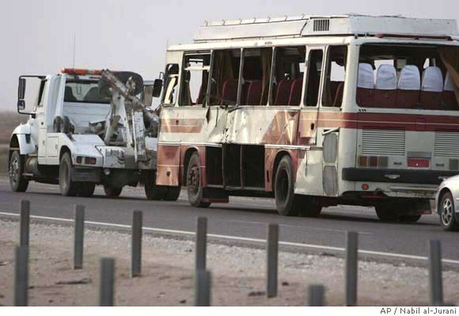 ###Live Caption:A bus that was hit by a roadside bomb is towed away near Nasiriyah, about 320 kilometers (200 miles) southeast of Baghdad, Iraq, Tuesday, March, 11, 2008. At least 16 civilians aboard died and another 22 were wounded in the blast. (AP Photo/Nabil al-Jurani)###Caption History:A bus that was hit by a roadside bomb is towed away near Nasiriyah, about 320 kilometers (200 miles) southeast of Baghdad, Iraq, Tuesday, March, 11, 2008. At least 16 civilians aboard died and another 22 were wounded in the blast. (AP Photo/Nabil al-Jurani)###Notes:###Special Instructions: Photo: NABIL AL-JURANI