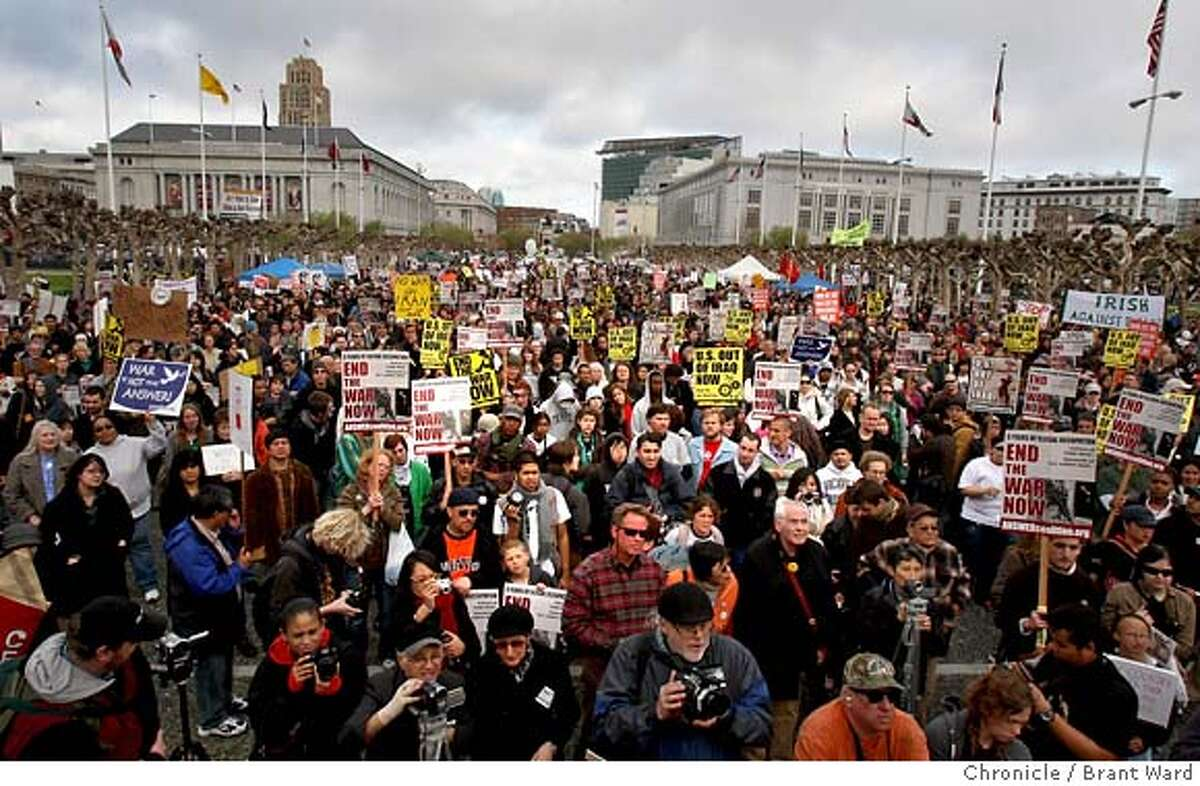 Protesters filled Civic Center Plaza to listen to speaches before a march into the Mission district. The five year anniversary of the Iraq war was remembered by protesters at San Francisco's Civic Center Wednesday, March 19, 2007. Photo by Brant Ward / San Francisco Chronicle