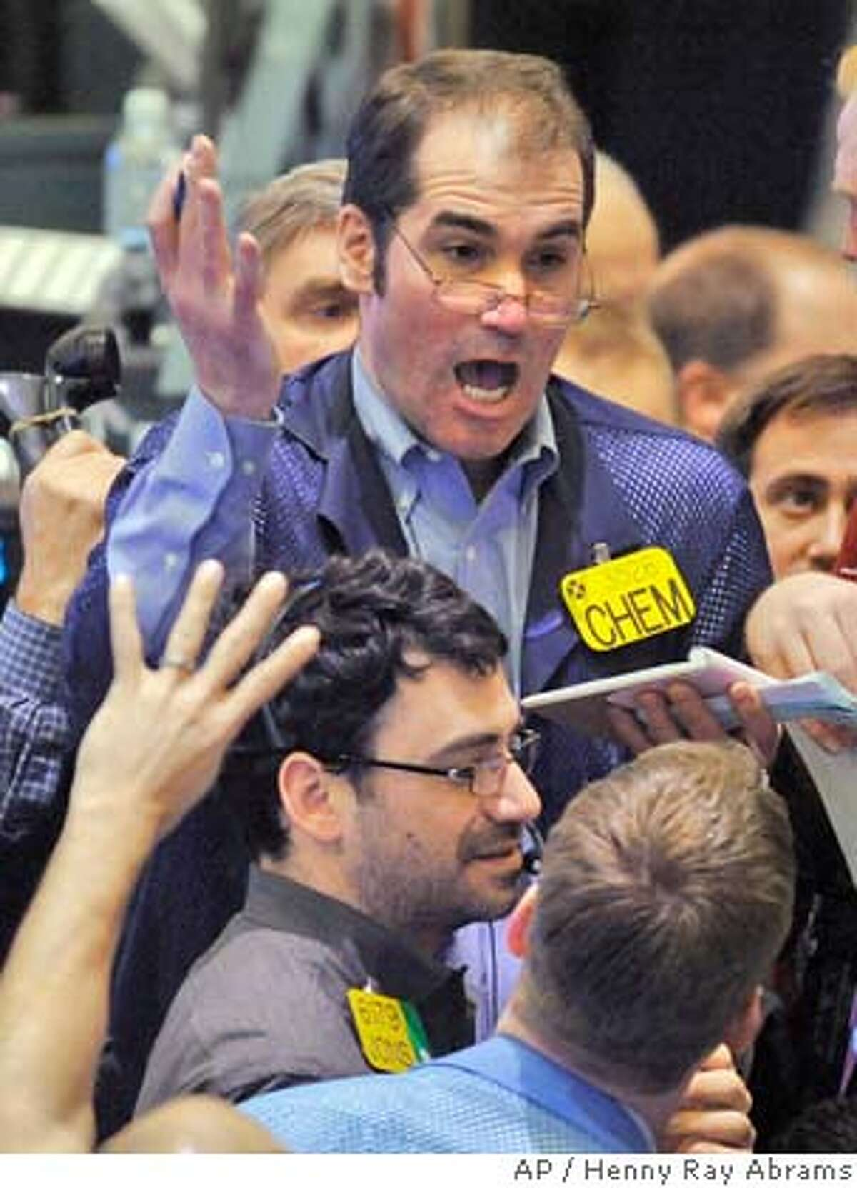 A trader makes his voice heard in the crude oil and natural gas options pit on the floor of the New York Mercantile Exchange in New York, Thursday, Mar. 13, 2008. Gas and oil prices jumped to new highs as the dollar weakened and investors shrugged off fresh evidence of a U.S. economic slowdown. (AP Photo/Henny Ray Abrams)