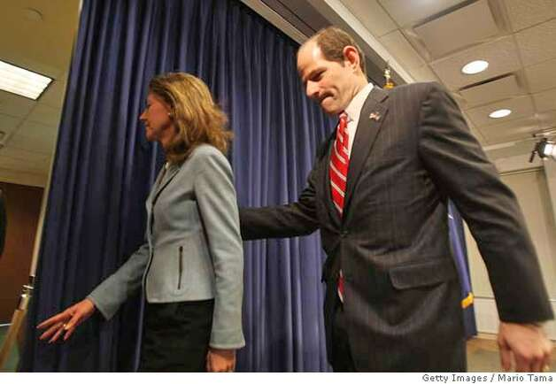 ###Live Caption:NEW YORK - MARCH 10: New York Governor Eliot Spitzer exits with his wife Silda Wall Spitzer after delivering an apology to his family and the public following reported links to a prostitution ring March 10, 2008 in New York City. Spitzer apologized to his family and public during the press conference but did not directly address the reports of his being linked to a prostitution ring. (Photo by Mario Tama/Getty Images)###Caption History:NEW YORK - MARCH 10: New York Governor Eliot Spitzer exits with his wife Silda Wall Spitzer after delivering an apology to his family and the public following reported links to a prostitution ring March 10, 2008 in New York City. Spitzer apologized to his family and public during the press conference but did not directly address the reports of his being linked to a prostitution ring. (Photo by Mario Tama/Getty Images)###Notes:New York Gov. Eliot Spitzer Linked To Prostitution Ring###Special Instructions: Photo: Mario Tama