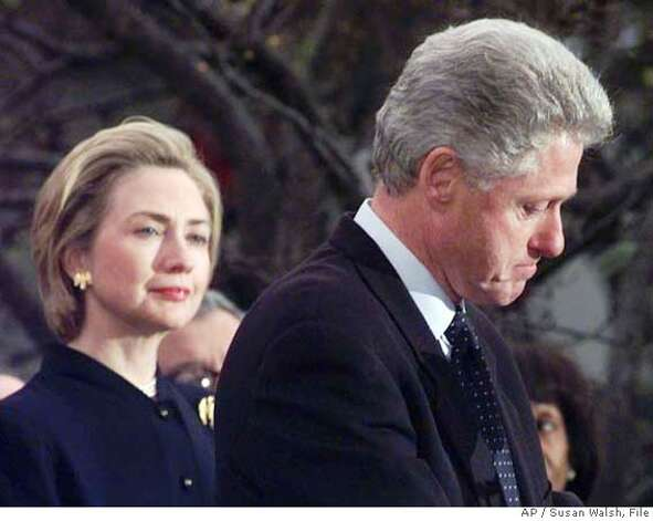 "###Live Caption:** FILE ** First lady Hillary Rodham Clinton watches President Clinton pause as he thanks those Democratic members of the House of Representatives who voted against impeachment in this Dec. 19, 1998 file photo. Her husband's dalliances with Monica Lewinsky left Americans baffled, and at the same time admiring, that Hillary would stand by her husband. ""The most difficult decisions I have made in my life were to stay married to Bill, and to run for the Senate from New York,"" she said. She decided she wanted the marriage to last, if that was possible. (AP Photo/Susan Walsh, File)###Caption History:** FILE ** First lady Hillary Rodham Clinton watches President Clinton pause as he thanks those Democratic members of the House of Representatives who voted against impeachment in this Dec. 19, 1998 file photo. Her husband's dalliances with Monica Lewinsky left Americans baffled, and at the same time admiring, that Hillary would stand by her husband. ""The most difficult decisions I have made in my life were to stay married to Bill, and to run for the Senate from New York,"" she said. She decided she wanted the marriage to last, if that was possible. (AP Photo/Susan Walsh, File)###Notes:bil Clinton, Hillary Clinton###Special Instructions:A DEC. 19, 1998 FILE PHOTO Photo: SUSAN WALSH"