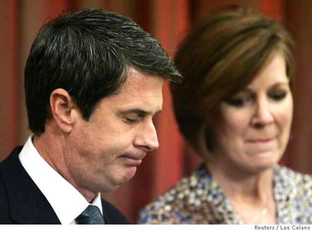 ###Live Caption:U.S. Senator David Vitter (R-LA) bows his head, as he makes a statement with his wife Wendy, during a news conference explaining his former involvement with prostitutes in Metairie,###Caption History:U.S. Senator David Vitter (R-LA) bows his head, as he makes a statement with his wife Wendy, during a news conference explaining his former involvement with prostitutes in Metairie, Louisiana July 16, 2007. REUTERS/Lee Celano (UNITED STATES)  Ran on: 07-17-2007  Sen. David Vitter bows his head while addressing the media with his wife, Wendy, in Metairie, La.###Notes:###Special Instructions:0 Photo: LEE CELANO
