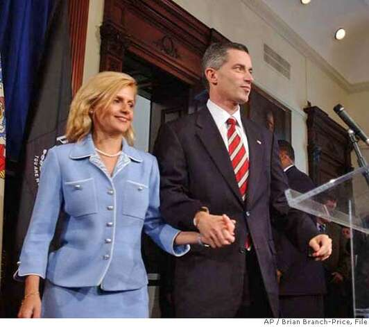 ###Live Caption:New Jersey Gov. James E. McGreevey, right, holds his wife Dina Matos McGreevey's hand, before announcing he will resign, during a news conference at the Statehouse in Trenton, N.J., Thursday, Aug. 12, 2004. In a stunning declaration, McGreevey announced his resignation Thursday and acknowledged that he had an extramarital affair with another man. The Democrat said his resignation would be effective Nov. 15. (AP Photo/Brian Branch-Price)###Caption History:*** CORRECTS SPELLING TO DINA MATOS MCGREEVEY ** New Jersey Gov. James E. McGreevey, right, holds his wife Dina Matos McGreevey's hand, before announcing he will resign, during a news conference at the Statehouse in Trenton, N.J., Thursday, Aug. 12, 2004. In a stunning declaration, McGreevey announced his resignation Thursday and acknowledged that he had an extramarital affair with another man. The Democrat said his resignation would be effective Nov. 15. (AP Photo/Brian Branch-Price) Ran on: 08-13-2004  Gov. James McGreevey Ran on: 08-20-2004  New Jersey Gov. James E. McGreevey (right) holds the hand of his second wife, Dina Matos McGreevey, before announcing he is gay.  ALSO Ran on: 10-17-2006  James McGreevey, the former governor of New Jersey, discusses coming out as &quo;a gay American&quo; and resigning from office in 2004 at a forum in San Francisco.###Notes:###Special Instructions:CORRECTS SPELLING TO DINA MATOS MCGREEVEY Photo: BRIAN BRANCH PRICE