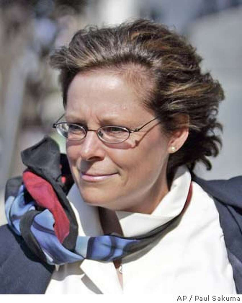 Stephanie Jensen, former vice president of human resources of Brocade Communications Systems Inc., leaves a federal courthouse in San Francisco, Wednesday, Aug. 2, 2006. Jensen went on trial Monday, Nov. 26, 2007 in U.S. District Court in San Francisco on felony charges of conspiracy and falsifying corporate records. She faces up to 25 years in prison if convicted on both charges. (AP Photo/Paul Sakuma) A AUG 2, 2006 OTK.