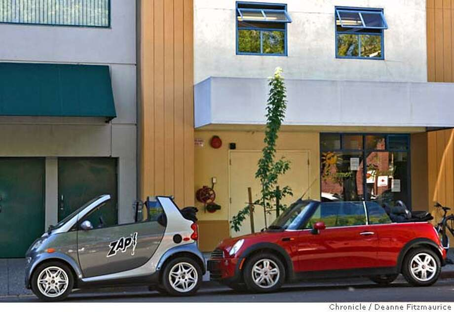###Live Caption:This Smart car, left, is parked next to a Mini Cooper in downtown Santa Rosa.###Caption History:smartcar_0289_df.jpg  This Smart car, left, is known as a micro car. It is parked next to a Mini Cooper in downtown Santa Rosa.  Chronicle Photo by Deanne Fitzmaurice###Notes:###Special Instructions:Mandatory credit for photographer and San Francisco Chronicle. No Sales/Magazines out. Photo: Deanne Fitzmaurice