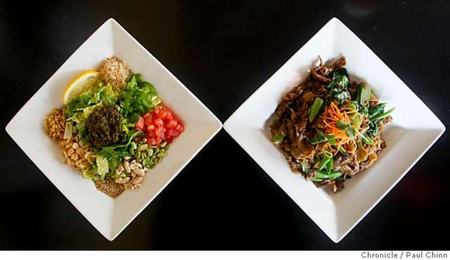 ###Live Caption:The tea leaf salad, left, and pad see you are displayed at Pagan Burmese-Thai restaurant in San Francisco, Calif., on Friday, March 7, 2008.  Photo by Paul Chinn / San Francisco Chronicle###Caption History:The tea leaf salad, left, and pad see you are displayed at Pagan Burmese-Thai restaurant in San Francisco, Calif., on Friday, March 7, 2008.  Photo by Paul Chinn / San Francisco Chronicle###Notes:pad see you (is spelled this way from the menu)###Special Instructions:MANDATORY CREDIT FOR PHOTOGRAPHER AND S.F. CHRONICLE/NO SALES - MAGS OUT Photo: Paul Chinn