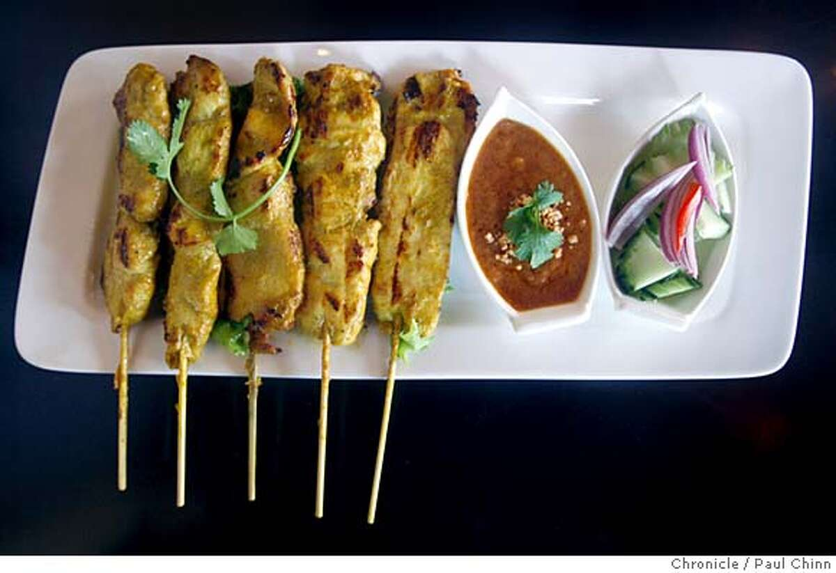 ###Live Caption:Chicken satay appetizers with peanut sauce at Pagan Burmese-Thai restaurant in San Francisco, Calif., on Friday, March 7, 2008. Photo by Paul Chinn / San Francisco Chronicle###Caption History:Chicken satay appetizers with peanut sauce at Pagan Burmese-Thai restaurant in San Francisco, Calif., on Friday, March 7, 2008. Photo by Paul Chinn / San Francisco Chronicle###Notes:###Special Instructions:MANDATORY CREDIT FOR PHOTOGRAPHER AND S.F. CHRONICLE/NO SALES - MAGS OUT