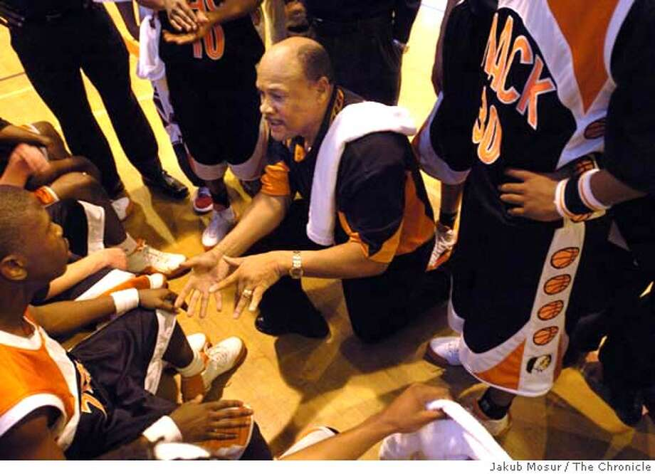 ###Live Caption:ss###Caption History:LIFEGOESON16_03_jmm.JPG Dwight Nathaniel coaches the McClymonds High School boys team during a game against Fremont High School in Oakland on Friday, Feb. 11, 2005. Story is about coaches and players who continue their athletic pursuits following the death of loved ones. Nathaniel's wife was killed in an auto accident about a year and a half ago. He was driving the car. Now, he says, his only saving grace since her death is coaching. It's kept him alive, he says. Event on 2/11/05 in Oakland. JAKUB MOSUR / The Chronicle###Notes:###Special Instructions:MANDATORY CREDIT FOR PHOTOG AND SF CHRONICLE/NO SALES-MAGS OUT Photo: JAKUB MOSUR