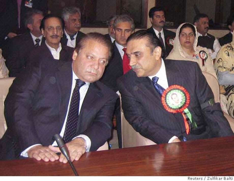 ###Live Caption:Pakistan Muslim League (PMLN) leader Nawaz Sharif (L) and Pakistan People's Party (PPP) leader Asif Ali Zardari talk during their joint meeting inside Parliament House in Islamabad March 17, 2008. Pakistan's new National Assembly was sworn in on Monday, setting the scene for a showdown with President Pervez Musharraf a month after his opponents swept a general election. REUTERS/Zulfikar Balti (PAKISTAN)###Caption History:Pakistan Muslim League (PMLN) leader Nawaz Sharif (L) and Pakistan People's Party (PPP) leader Asif Ali Zardari talk during their joint meeting inside Parliament House in Islamabad March 17, 2008. Pakistan's new National Assembly was sworn in on Monday, setting the scene for a showdown with President Pervez Musharraf a month after his opponents swept a general election. REUTERS/Zulfikar Balti (PAKISTAN)###Notes:PMLN leader Nawaz Sharif and PPP leader Asif Ali Zardari talk during their joint meeting inside Parliament House in Islamabad###Special Instructions:0 Photo: STR/PAKISTAN