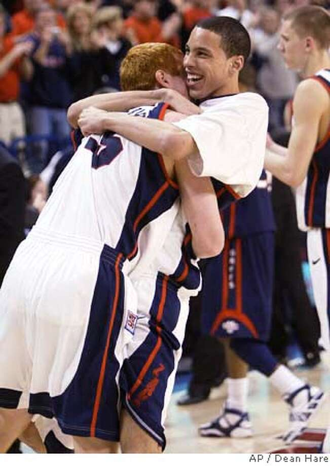 ###Live Caption:Gonzaga players David Pendergraft, left, and Austin Daye celebrate after defeating Saint Mary's 88-76 in a college basketball game Saturday March 1, 2008 at the McCarthey Athletic Center in Spokane, Wash. (AP Photo/Dean Hare)###Caption History:Gonzaga players David Pendergraft, left, and Austin Daye celebrate after defeating Saint Mary's 88-76 in a college basketball game Saturday March 1, 2008 at the McCarthey Athletic Center in Spokane, Wash. (AP Photo/Dean Hare)  Ran on: 03-02-2008  Austin Daye (right) hugs David Pendergraft to celebrate as Gonzaga clinches at least a tie for the conference title.###Notes:Austin Daye, David Pendergraft###Special Instructions:EFE OUT Photo: Dean Hare
