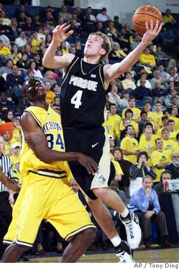 ###Live Caption:Purdue guard Robbie Hummel (4) hooks a shot over Michigan forward DeShawn Sims (34) in the first half of a college basketball game, Sunday, March 9, 2008, in Ann Arbor, Mich. Purdue won 72-58. (AP Photo/Tony Ding)###Caption History:Purdue guard Robbie Hummel (4) hooks a shot over Michigan forward DeShawn Sims (34) in the first half of a college basketball game, Sunday, March 9, 2008, in Ann Arbor, Mich. Purdue won 72-58. (AP Photo/Tony Ding)###Notes:Robbie Hummel, DeShawn Sims###Special Instructions:EFE OUT Photo: Tony Ding