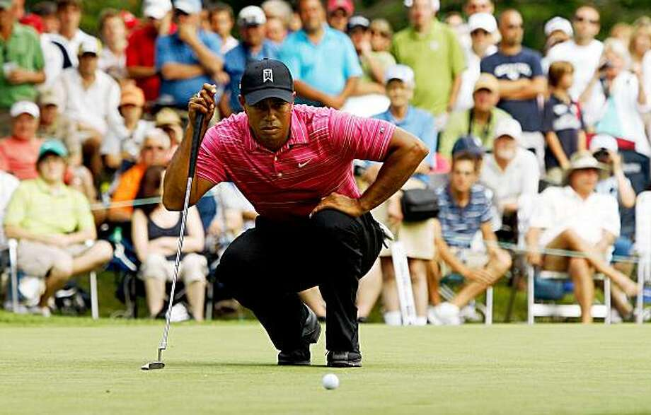 GRAND BLANC, MI - JULY 30:  Tiger Woods lines up a putt on the 17th hole during round one of the Buick Open at Warwick Hills Golf and Country Club on July 30, 2009 in Grand Blanc, Michigan.  (Photo by Chris Graythen/Getty Images) Photo: Chris Graythen, Getty Images