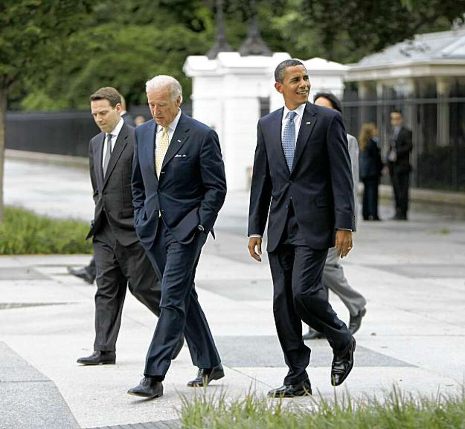 President Barack Obama, right, and Vice President Joe Biden, left, walk out of the White House and across Pennsylvania Ave. to the Blair House in Washington, Friday, July 31, 2009. Obama is hosting a meeting with members of the Cabinet at the Blair House, the government's official guest house. (AP Photo/Pablo Martinez Monsivais) Photo: Pablo Martinez Monsivais, AP