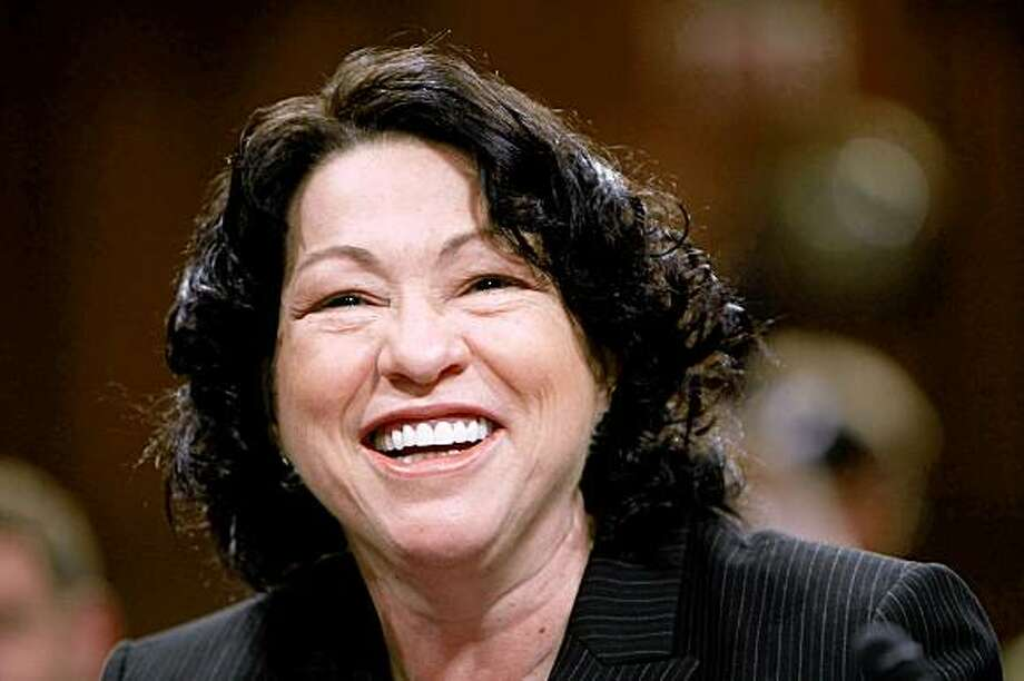 WASHINGTON - JULY 15:  Supreme Court nominee Judge Sonia Sotomayor smiles as she arrives for the third day of confirmation hearings before the Senate Judiciary Committee July 15, 2009 in Washington, DC. Sotomayor faces a day of questioning from Senators on the committee and also a closed session.  (Photo by Win McNamee/Getty Images) Photo: Win McNamee, Getty Images