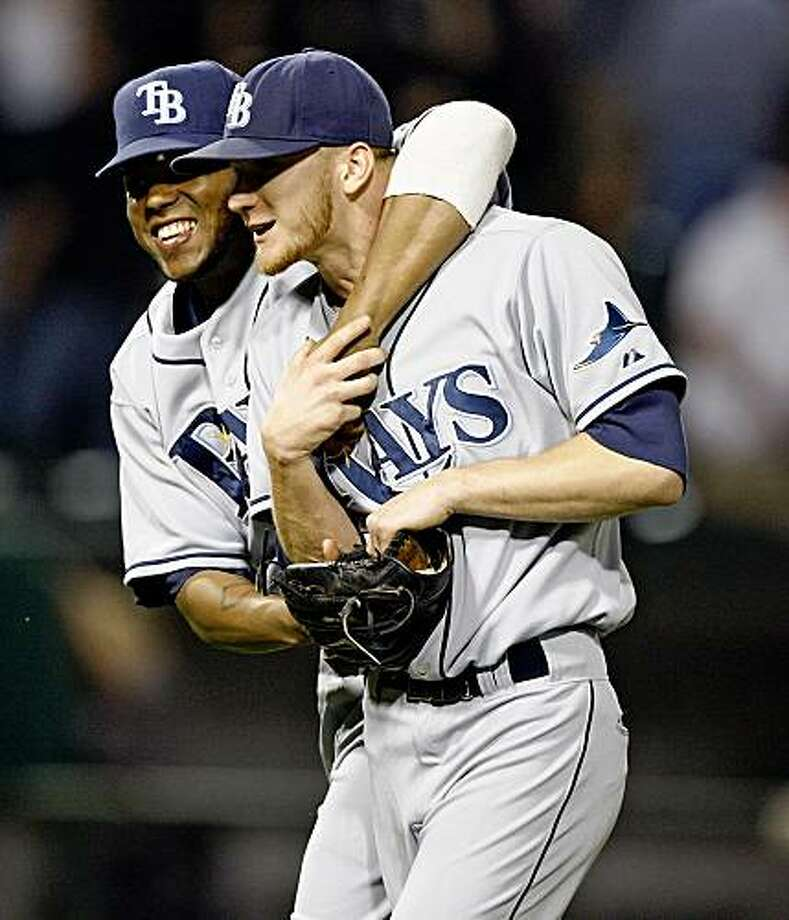 Tampa Bay Rays' Willy Aybar, left, hugs J.P. Howell after the Rays defeated the Chicago White Sox 3-2 in a baseball game Tuesday, July 21, 2009, in Chicago. (AP Photo/Jim Prisching) Photo: Jim Prisching, AP