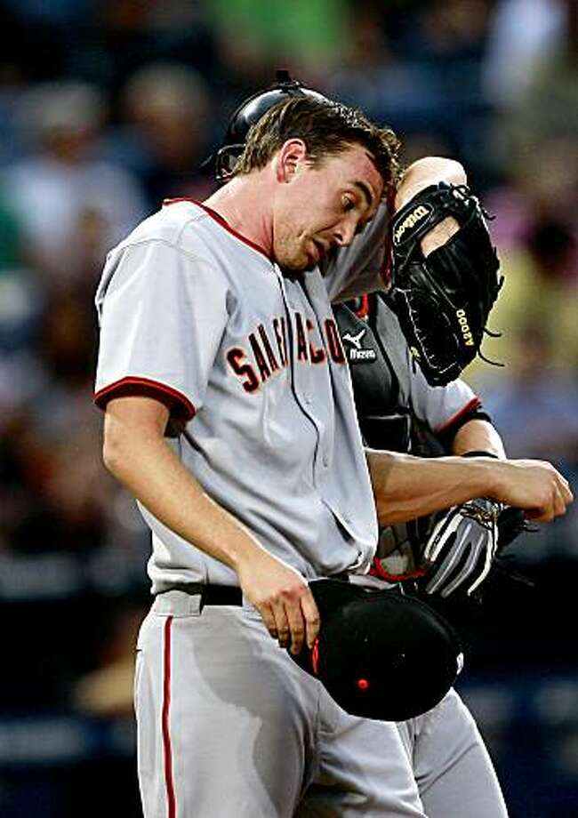 San Francisco Giants starter Ryan Sadowski wipes his head after allowing a run to score in the fourth inning of a baseball game against the Atlanta Braves in Atlanta, Tuesday July 21, 2009.  (AP Photo/John Bazemore) Photo: John Bazemore, AP