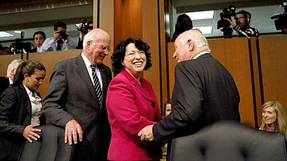 Supreme Court nominee Sonia Sotomayor, center, are congratulated by Sen. Patrick Leahy, D-Vt., left, and Senate Judiciary Committee member Sen. Ben Cardin, D-Md., after she finished her testimony on Capitol Hill in Washington, Thursday, July 16, 2009. (AP Photo/Charles Dharapak) Photo: Charles Dharapak, AP