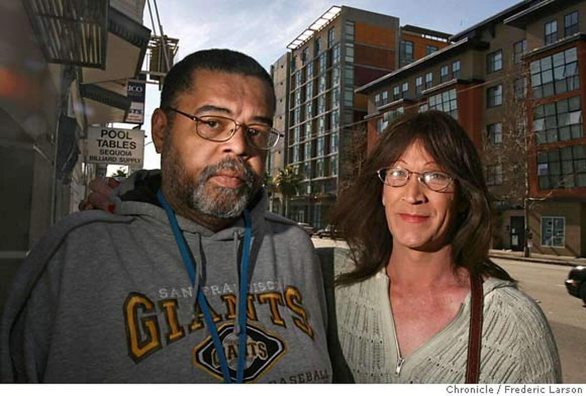 ###Live Caption:Lawrence and Rosie LaVere (l-r) stand 3/3/08 on Howard Street near where they live in supportive housing called