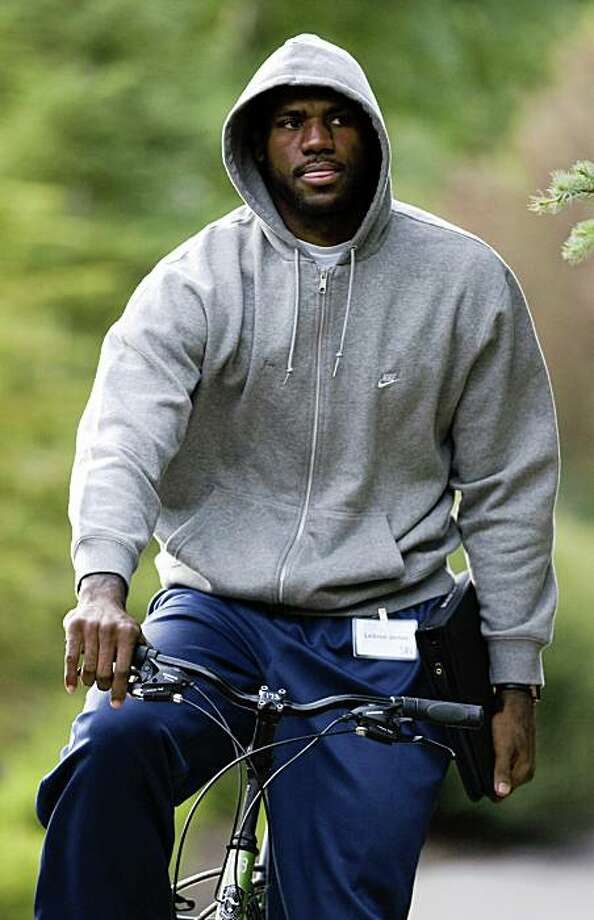 Cleveland Cavaliers star LeBron James rides a bicycle to a morning session at the annual Allen & Co.'s media summit in Sun Valley, Idaho, Friday, July 10, 2009. (AP Photo/Nati Harnik) Photo: Nati Harnik, AP