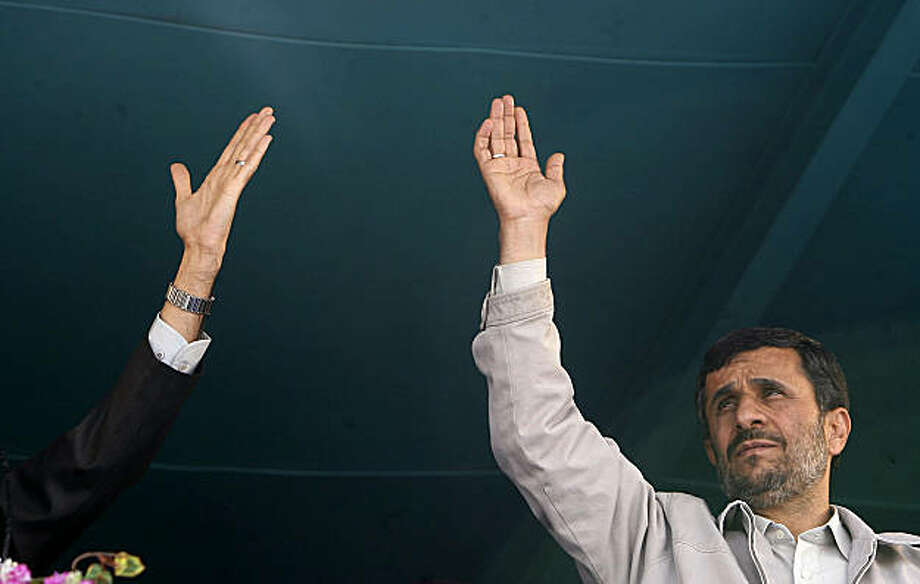 FILE - This April 8, 2009 file photo shows Iranian President Mahmoud Ahmadinejad, right, greeting his supporters in Isfahan, south of Tehran. The U.S. is hearing only silence from Iran on its offers of dialogue, despite setting a fall deadline for Tehran to accept. Iran's leaders, who previously seemed cautiously positive about talks, appear too overwhelmed with ensuring their hold on power in the postelection crisis. (AP photo/ISNA news agency/Amir Pourmandi, File) Photo: Amir Pourmandi, AP