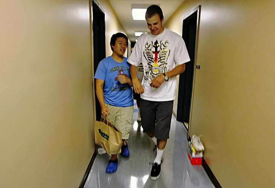 Jimmy Chang and Ignus Tavilonis  make their way through the hall as they head out to dinner,  Wednesday May 27, 2009, Portola Valley, Calif. Photo: Lacy Atkins, The Chronicle