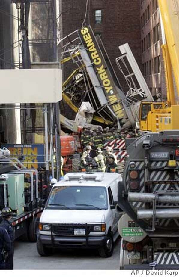 ###Live Caption:Members of various emergency services units get ready to remove a third body from the site of the crane collapse on 2nd Ave. and 50th St. in Manhattan, New York Monday, March 17, 2008 (AP Photo/David Karp)###Caption History:Members of various emergency services units get ready to remove a third body from the site of the crane collapse on 2nd Ave. and 50th St. in Manhattan, New York Monday, March 17, 2008 (AP Photo/David Karp)###Notes:###Special Instructions: Photo: DAVID KARP