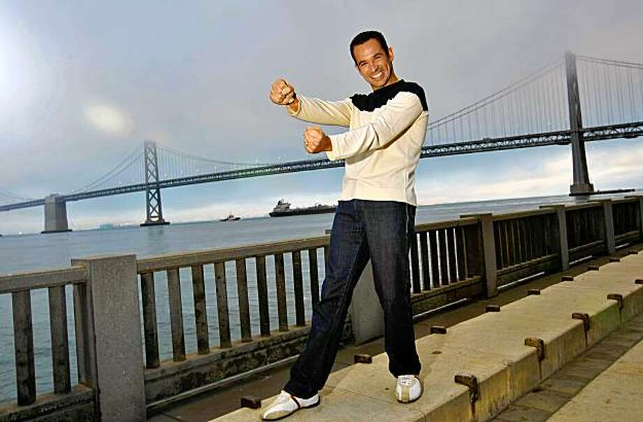 Race car driver Helio Castroneves poses for a photograph along the Embarcadero, Monday July 27, 2009, in San Francisco, Calif. Photo: Lacy Atkins, The Chronicle