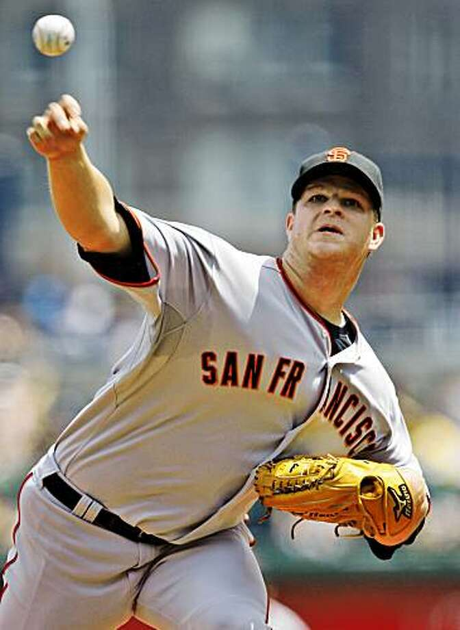 San Francisco Giants pitcher Matt Cain throws in the third inning against the Pittsburgh Pirates during a baseball game in Pittsburgh on Sunday, July 19, 2009. Cain got his 11th win of the season in the Giants' 4-3 win. Photo: Gene J. Puskar, Associated Press