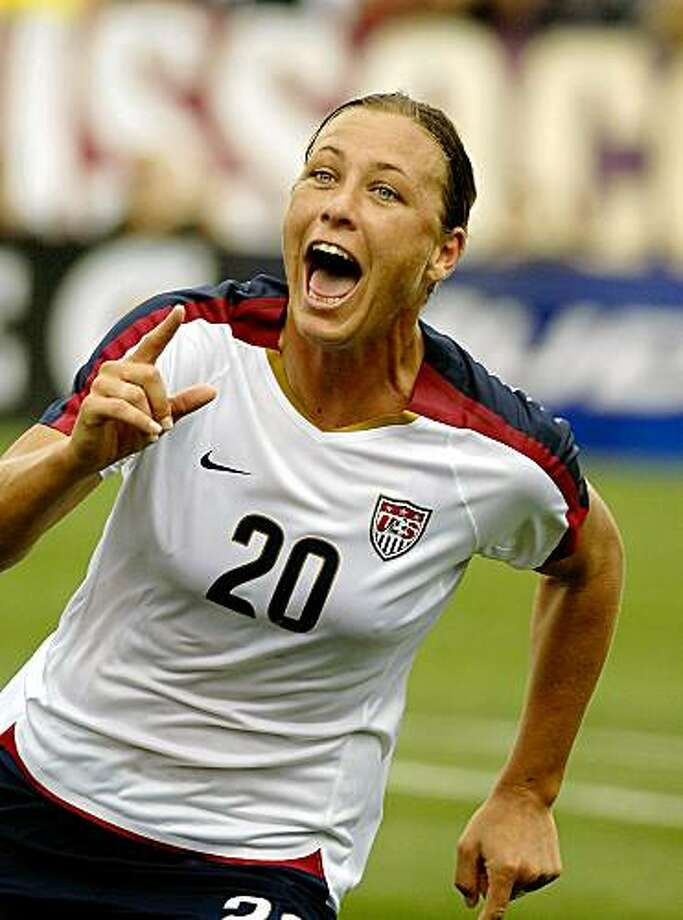 United States' Abby Wambach celebrates her 100th goal in an international exhibition soccer match against Canada in Rochester, N.Y. on Sunday, July 19, 2009. US won 1-0. (AP Photo/Don Heupel) Photo: Don Heupel, AP