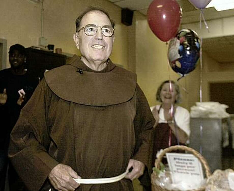 Father Floyd Lotito listens as diners sing him happy birthday.   Father Floyd Lotito celebrates his 70th birthday at St. Anthony Dining Room. He was given a cake before the lunch was served. After the cake, he helped serve meals to the folks coming to the dining room for a free, hot meal. St. Anthony Dining room serves an average of 2200 people a day. Photo: Liz Mangelsdorf, The Chronicle
