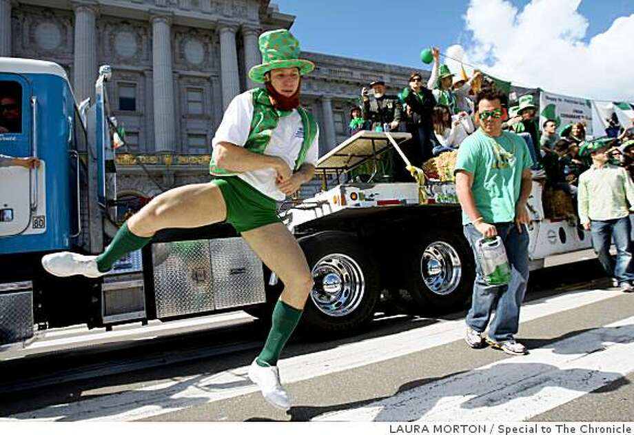 Michael Marshall does a little jig for the judges outside City Hall while marching in the San Francisco St. Patrick's Day Parade in San Francisco, Calif., on Saturday, March 15, 2008.Photo by Laura Morton / Special to The Chronicle Photo: LAURA MORTON, Special To The Chronicle