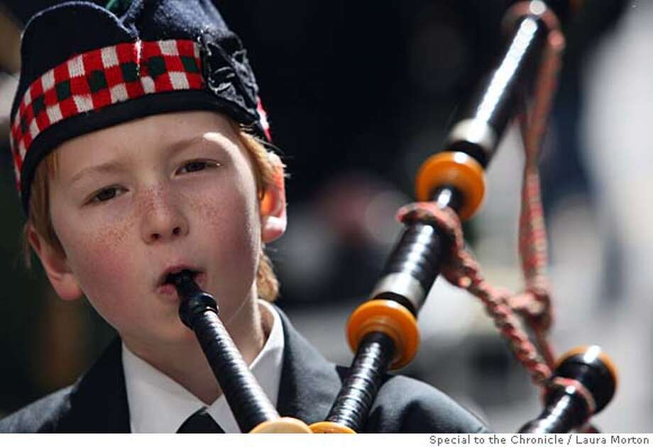 Aiden Foster Evans, age 10, plays the bagpipes with the Irish Pipers of San Francisco while marching in the San Francisco St. Patrick's Day in San Francisco, Calif., on Saturday, March 15, 2008. Photo by Laura Morton / Special to The Chronicle Photo: LAURA MORTON
