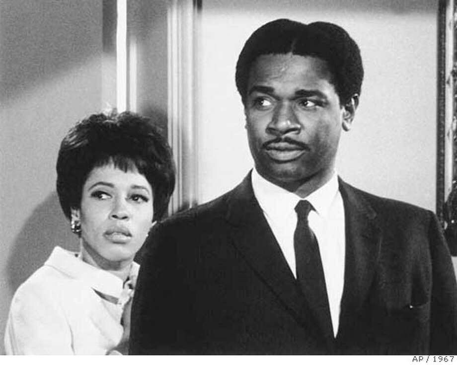 "###Live Caption:In this March 1967 photo, actor Ivan Dixon and actress Diana Sands are seen in an episode of the ABC-TV show ""The Fugitive."" Dixon, who brought the problems and promise of contemporary blacks to life in the film ""Nothing But a Man"" and portrayed the levelheaded POW Kinchloe in TV's ""Hogan's Heroes,"" has died. He was 76. Dixon died Sunday, March 16, 2008, at Presbyterian Hospital in Charlotte, N.C., after a hemorrhage, said his daughter, Doris Nomathande Dixon of Charlotte. He had suffered complications from kidney failure, she said. (AP Photo/File) ** NO SALES **###Caption History:In this March 1967 photo, actor Ivan Dixon and actress Diana Sands are seen in an episode of the ABC-TV show ""The Fugitive."" Dixon, who brought the problems and promise of contemporary blacks to life in the film ""Nothing But a Man"" and portrayed the levelheaded POW Kinchloe in TV's ""Hogan's Heroes,"" has died. He was 76. Dixon died Sunday, March 16, 2008, at Presbyterian Hospital in Charlotte, N.C., after a hemorrhage, said his daughter, Doris Nomathande Dixon of Charlotte. He had suffered complications from kidney failure, she said. (AP Photo/File) ** NO SALES **###Notes:Ivan Dixon, Diana Sands###Special Instructions:UNDATED PHOTO NO SALES Photo: Ap"