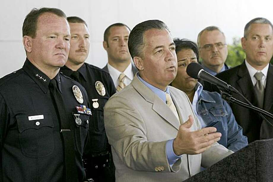 Assistant Chief of Police Jim McDonnell, left, listens as Deputy Chief Sergio Diaz, center, speaks Monday, July 27, 2009, during a news conference regarding the murder 17-year-old Lily Burk. A 50-year-old parolee, Charlie Samuel, was booked for investigation of the murder of Burk at 11:45 p.m. Sunday after fingerprints in Burk's car linked him to the killing, Diaz contended at the news conference. (AP Photo/Nick Ut) Photo: Nick Ut, AP