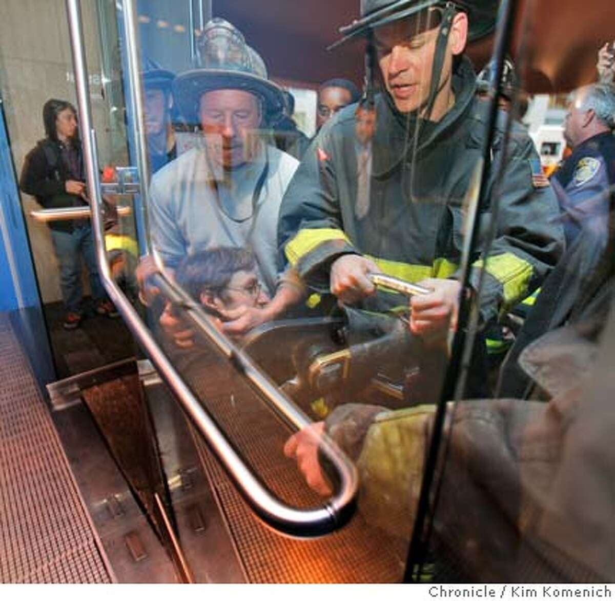 Although they ultimately didn't need to use it, San Francisco firefighters test a pneumatic cutting device on a rail where U.C. Berkeley senior Michael Taylor used a bicycle lock to chain himself to the west entrance to the William H. Rutter Center at UCSF Mission Bay. Taylor was part of a protest against the U.C. Regents, who would meet inside a few hours later. Taylor ultimately gave the key to officials and was detained. Photo by Kim Komenich / The San Francisco Chronicle