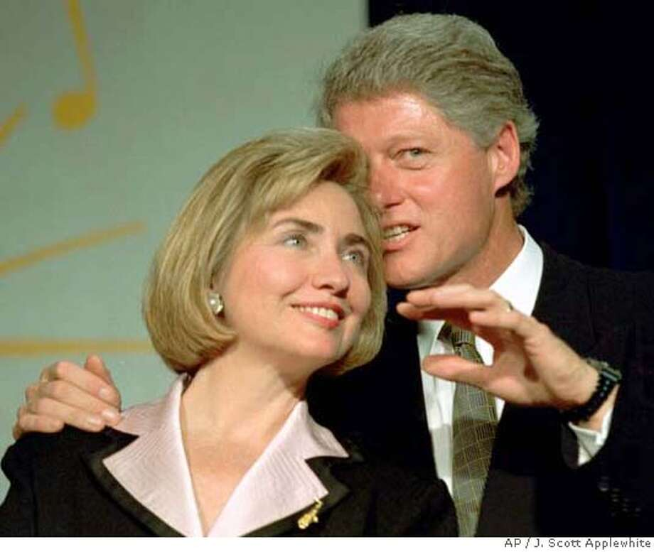 ###Live Caption:President Clinton whispers to first lady Hillary Rodham Clinton while waiting to address a group of young Democratic supporters know as the Saxophone Club in Washington Wednesday, June 22, 1994. The group cheered, whistled and stomped as a wound-up president delivered his 1994 stump speech and verbally thrashed Republicans who try to block health care reform legislation.  (AP Photo/J. Scott Applewhite)###Caption History:President Clinton whispers to first lady Hillary Rodham Clinton while waiting to address a group of young Democratic supporters know as the Saxophone Club in Washington Wednesday, June 22, 1994. The group cheered, whistled and stomped as a wound-up president delivered his 1994 stump speech and verbally thrashed Republicans who try to block health care reform legislation. (AP Photo/J. Scott Applewhite)###Notes:###Special Instructions:CAT Photo: J. SCOTT APPLEWHITE