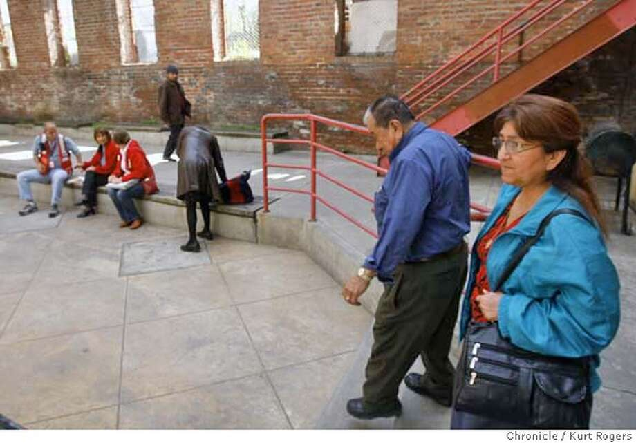 ###Live Caption:Hugo Gonzalez, 74, and his friend Griselda Paleo, 59, walk across the patio at the Red Cross shelter set up at the Mission Community Recreation center on Harrison Street in San Francisco, Calif., on Tuesday, March 18, 2008 where the Red Cross has set up shelter for the victims of a Valencia Street fire. Photo by Kurt Rogers / San Francisco Chronicle###Caption History:Hugo Gonzalez 74 and his friend Griselda Paleo 59 walk across the patio at the Red Cross shelter set up at the Mission community recreation center on Harrison St in San Francisco. They don�t know what they are going to do after living in the building at 1476 Valencia St for twenty years  Tuesday March 18 2008.  Photo By Kurt Rogers / San Francisco Chronicle###Notes:Fire of Valencia st 3/17/08  Hugo Gonzalez Griselda Paleo###Special Instructions:MANDATORY CREDIT FOR PHOTOG AND SAN FRANCISCO CHRONICLE/NO SALES-MAGS OUT Photo: Kurt Rogers