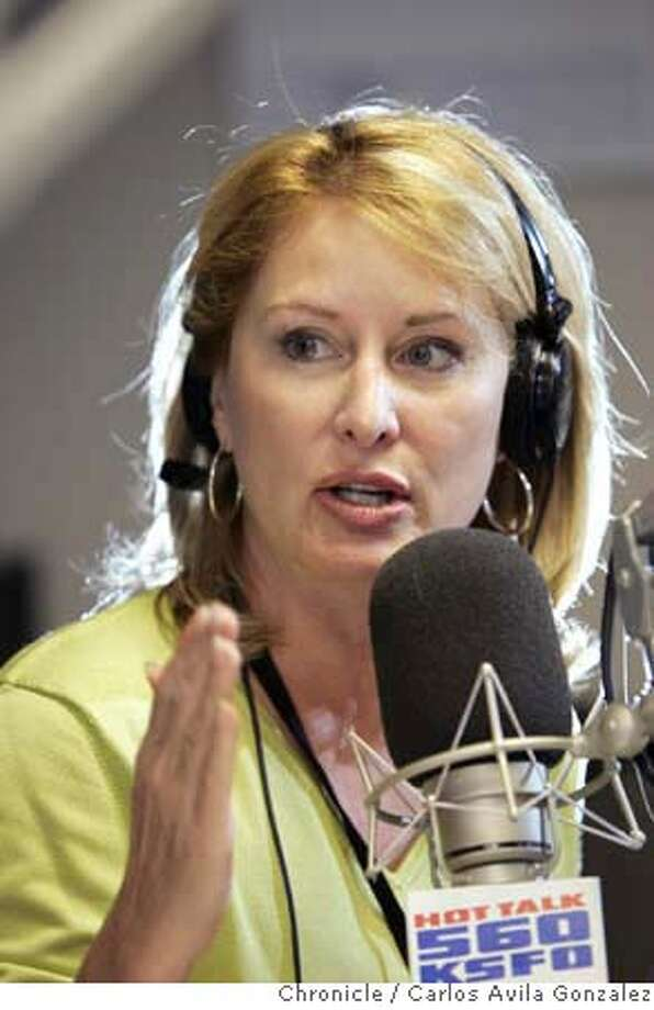 ###Live Caption:Melanie Morgan, a conservative talk show host on KSFO-AM. Until about a dozen years ago, she was a straight news reporter on KGO and elsewhere. But in the past couple of years, she's become a nationally-known activist, leading the charge to recall Gray Davis; running counter-protests to Cindy Sheehan; and being ripped by liberal media watchdog groups for calling for the death penalty for NYT editor Bill Keller, should he be tried for treason (for leaking confidential information.). She's a rarity -- a conservative activist living in Marin County. She's a recovering gambler (and subject of a made-for-TV movie); mother of a teen boy. This fall, she will release a book contrasting the lives of Sheehan and another family that lost a child in the war that's sure to fire up the troops on both sides of the red-blue divide. Photo by Carlos Avila Gonzalez/The San Francisco Chronicle Photo taken on 8/14/06, in San Francisco, Ca, USA **All names cq (roster) Ran on: 10-08-2006 Morgan at the mike from which she led the charge to recall Gov. Davis and rails against Spare the Air Day in the KSFO studios. Ran on: 01-11-2007 Clips from hosts Lee Rodgers, above, and Melanie Morgan, left, were sent by the blogger to KSFO advertisers. Rodgers suggested that a protester be &quo;stomped to death&quo; and Morgan spoke of a bull's-eye over Nancy Pelosi's eyes.###Caption History:MORGANXX_042_CAG.TIF  Melanie Morgan, a conservative talk show host on KSFO-AM. Until about a dozen years ago, she was a straight news reporter on KGO and elsewhere. But in the past couple of years, she's become a nationally-known activist, leading the charge to recall Gray Davis; running counter-protests to Cindy Sheehan; and being ripped by liberal media watchdog groups for calling for the death penalty for NYT editor Bill Keller, should he be tried for treason (for leaking confidential information.). She's a rarity -- a conservative activist living in Marin County. She's a re Photo: Carlos Avila G
