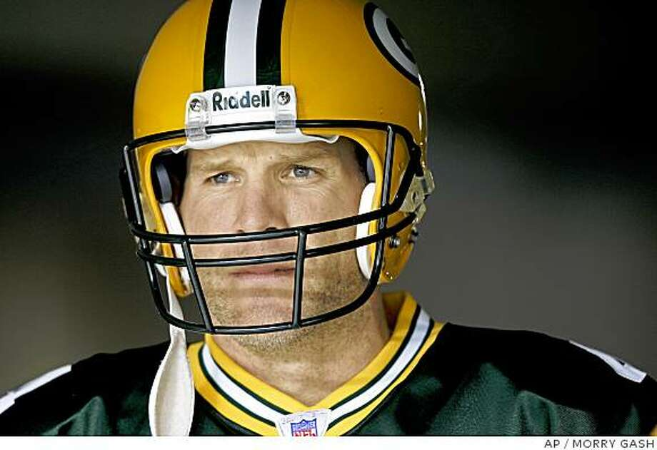 ** FILE ** Green Bay Packers quarterback Brett Favre waits to be introduced before their  NFL football game against the Seattle Seahawks in Green Bay, Wis.., in this Jan. 1, 2006 file photo. Brett Favre has decided to retire from the NFL after 17 seasons. FOX Sports first reported Tuesday March 4, 2008 that the Green Bay Packers quarterback informed the team in the last few days. (AP Photo/Morry Gash, file) Photo: MORRY GASH, AP