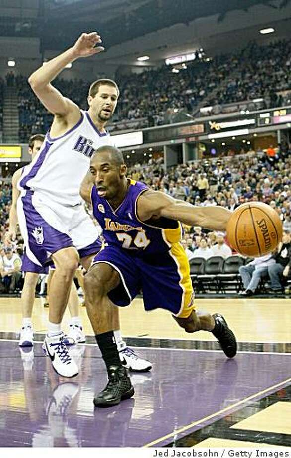 SACRAMENTO, CA - MARCH 04:  Kobe Bryant #24 of the Los Angeles Lakers grabs a rebound past Brad Miller #52 of the Sacramento Kings during an NBA game on March 4, 2008 at ARCO Arena in Sacramento, California. NOTE TO USER: User expressly acknowledges and agrees that, by downloading and/or using this Photograph, user is consenting to the terms and conditions of the Getty Images License Agreement.  (Photo by Jed Jacobsohn/Getty Images) Photo: Jed Jacobsohn, Getty Images