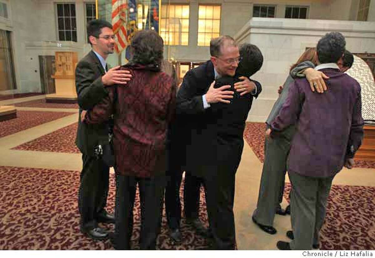 ###Live Caption:Stuart Gafney, left, hugs Myra Beals while John Lewis hugs Ida Matson after a press conference with petitioners at City Hall, meeting before the California Supreme Court hear oral arguments at 9 a.m. Tuesday in the same-sex marriage case., March 4, 2008, in San Francisco, Calif. Photo by Liz Hafalia/San Francisco Chronicle###Caption History:Stuart Gafney (left) and John Lewis (middle) hug Myra Beals (left) and Ida Matson (middle) after a press conference with petitioners at City Hall, meeting before the California Supreme Court hear oral arguments at 9 a.m. Tuesday in the same-sex marriage case., March 4, 2008, in San Francisco, Calif. Photo by Liz Hafalia/San Francisco Chronicle###Notes:Stuart Gafney (left) and John Lewis (middle) hug Myra Beals (left) and Ida Matson (middle) after a press conference with petitioners at City Hall, meeting before the California Supreme Court hear oral arguments at 9 a.m. Tuesday in the same-sex marriag###Special Instructions:�2008, San Francisco Chronicle/ Liz Hafalia MANDATORY CREDIT FOR PHOTOG AND SAN FRANCISCO CHRONICLE. NO SALES- MAGS OUT.