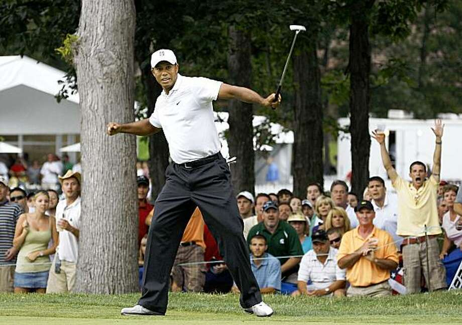 GRAND BLANC, MI - AUGUST 01:  Tiger Woods reacts after making a birdie putt on the 17th green during the third round of the Buick Open at Warwick Hills Golf and Country Club on August 1, 2009 in Grand Blanc, Michigan.  (Photo by Gregory Shamus/Getty Images) Photo: Gregory Shamus, Getty Images