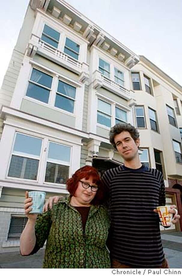 ###Live Caption:Karen Solomon and her husband Matthew Schaefer have coffee in front of their three-unit tenancy-in-common building in San Francisco, Calif., on Thursday, March 6, 2008. After years of trying, the couple's TIC arrangement is finally eligible for a condo conversion after winning in the city's competitive lottery system.  Photo by Paul Chinn / San Francisco Chronicle###Caption History:Karen Solomon and her husband Matthew Schaefer have coffee in front of their three-unit tenancy-in-common building in San Francisco, Calif., on Thursday, March 6, 2008. After years of trying, the couple's TIC arrangement is finally eligible for a condo conversion after winning in the city's competitive lottery system.  Photo by Paul Chinn / San Francisco Chronicle###Notes:Karen Solomon, Matthew Schaefer###Special Instructions:MANDATORY CREDIT FOR PHOTOGRAPHER AND S.F. CHRONICLE/NO SALES - MAGS OUT Photo: Paul Chinn