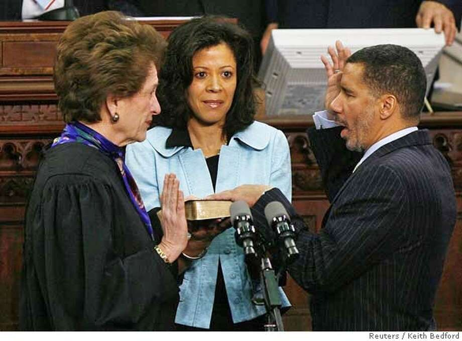 ###Live Caption:Hon. Judith S. Kaye (L), chief judge of the State of New York, swears in David Paterson (R) as the 55th governor of the State of New York during a ceremony at the state capitol building in Albany, New York March 17, 2008. Holding the bible is his wife Michelle Paige Paterson (C). REUTERS/Keith Bedford (UNITED STATES)###Caption History:Hon. Judith S. Kaye (L), chief judge of the State of New York, swears in David Paterson (R) as the 55th governor of the State of New York during a ceremony at the state capitol building in Albany, New York March 17, 2008. Holding the bible is his wife Michelle Paige Paterson (C). REUTERS/Keith Bedford (UNITED STATES)###Notes:Chief Judge of the State of New York Kaye swears in Paterson as the 55th governor of New York during a ceremony at the state capitol building in Albany###Special Instructions: Photo: KEITH BEDFORD