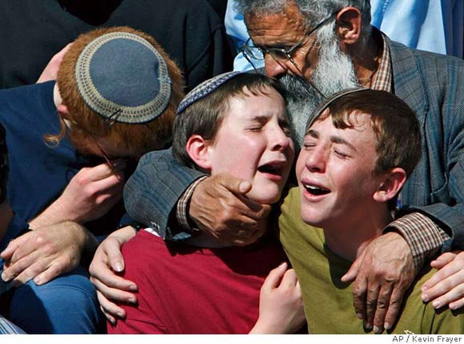###Live Caption:Israelis react during the funeral for eight Jewish yeshiva students that were killed in a shooting attack by a Palestinian gunman Thursday, at the Mercaz Harav Yeshiva in Jerusalem, Friday, March 7, 2008. The eight, most of them teenagers, were killed by a Palestinian gunmen in a nighttime attack on the library at the rabbinical seminary where they were studying.(AP Photo/Kevin Frayer)###Caption History:Israelis react during the funeral for eight Jewish yeshiva students that were killed in a shooting attack by a Palestinian gunman Thursday, at the Mercaz Harav Yeshiva in Jerusalem, Friday, March 7, 2008. The eight, most of them teenagers, were killed by a Palestinian gunmen in a nighttime attack on the library at the rabbinical seminary where they were studying.(AP Photo/Kevin Frayer)###Notes:###Special Instructions: Photo: Kevin Frayer